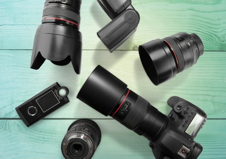 medium group of objects: Camera, Photographic Equipment, Lens.