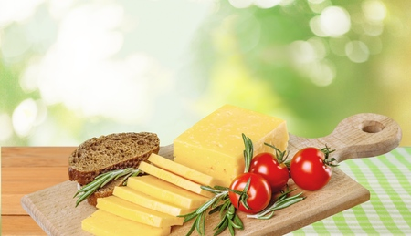 cheddar: Cheese, Cheddar, Tomato. Stock Photo