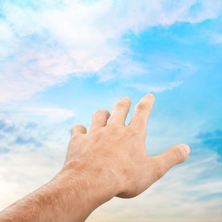 traumatized: Darkness, silhoutte, hand. Stock Photo