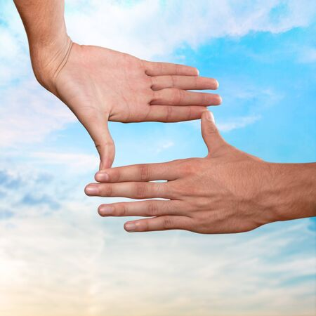 envision: Hands, sky, fingers. Stock Photo