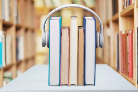storytelling: Headphones, Book, Listening.