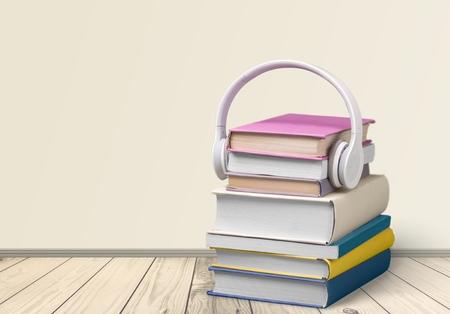 audio equipment: Headphones, Book, Audio Equipment.