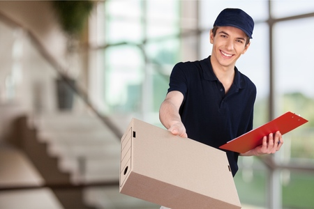 parcel service: Delivering. Stock Photo