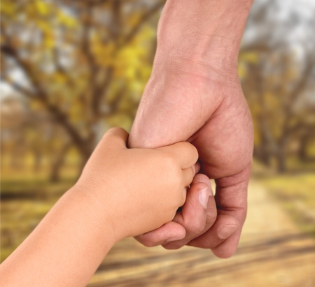 and holding hands: Holding Hands. Stock Photo