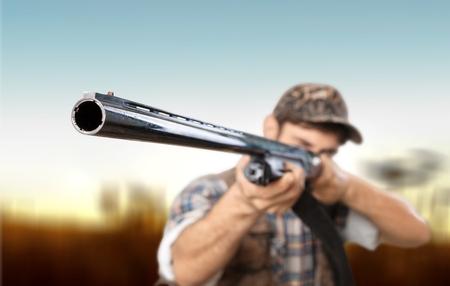 hombre disparando: Hunter. Foto de archivo