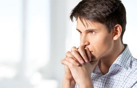 and anxiety: Praying. Stock Photo