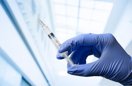 surgical needle: Injecting. Stock Photo