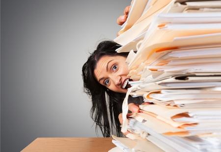 overburdened: Paperwork.