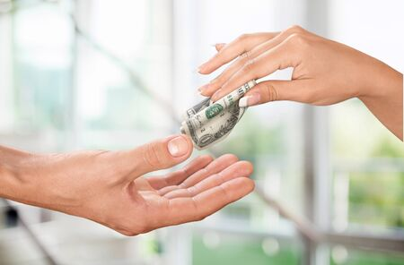 hand with money: Giving Money. Stock Photo