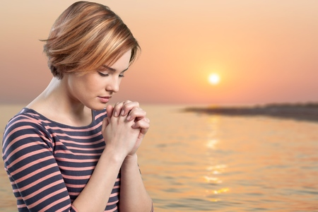 Praying. Stock Photo