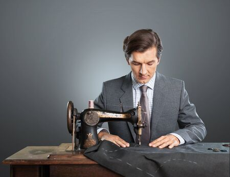 men in suit: Businessman sewing clothes