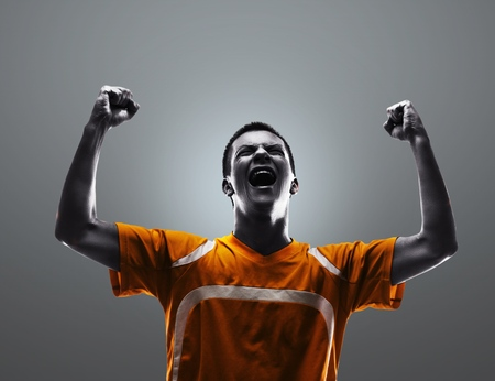 soccer player: Excited male soccer player
