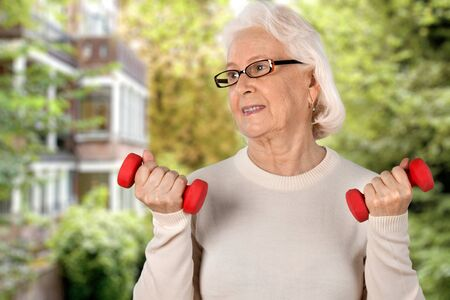 80 plus years: Senior woman holding dumbbell