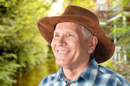 80 plus adult: Senior man with hat looking up Stock Photo