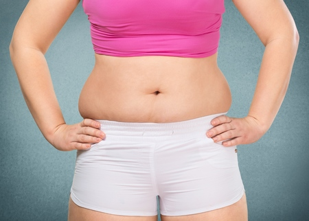 hands on waist: tummy of a overweight woman