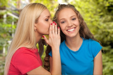 two person only: Two teenagers whispering  Stock Photo