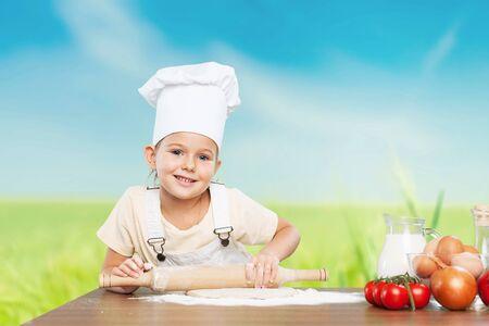 little dough: Little chef rolling dough