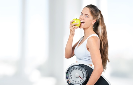 woman on scale: Dieting.