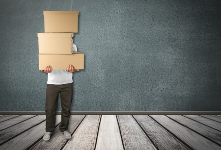 man carrying box: Box. Stock Photo