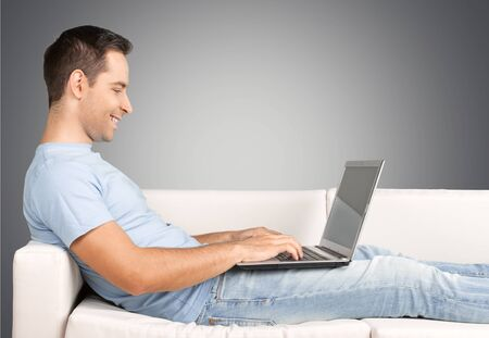 laptop home: Relaxed. Stock Photo