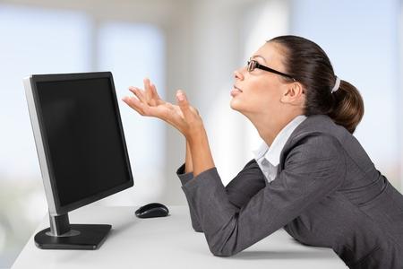looking at computer: Computer.