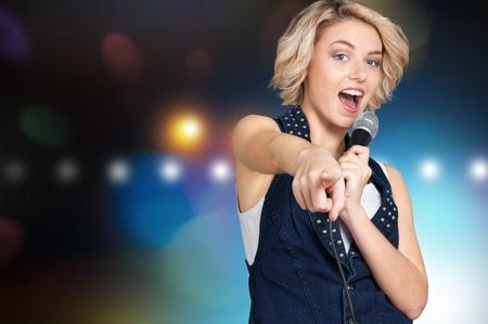singer with microphone: Karaoke.