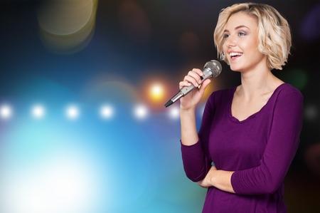using voice: Singing.