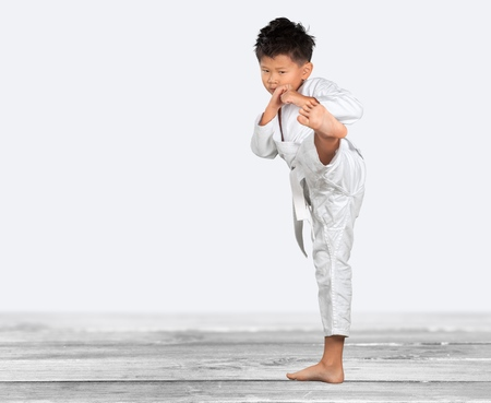 black belt: kid with Karate pose.