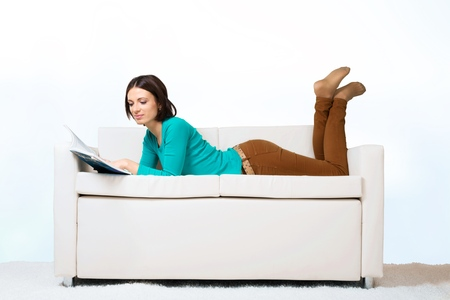woman lying: Sofa.