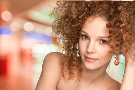 Pretty curly hair woman