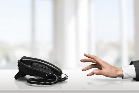 telephone: Reaching Telephone. Stock Photo