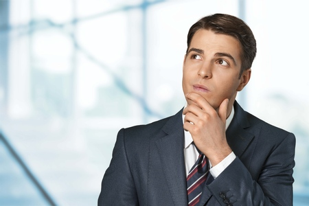 raised eyebrows: Thinking Businessman. Stock Photo