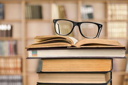 cramming: Books and glasses.
