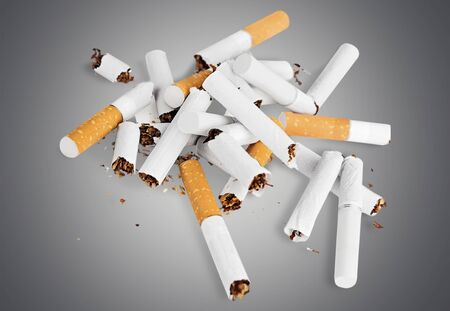 unhealthy living: Broken Cigarettes. Stock Photo