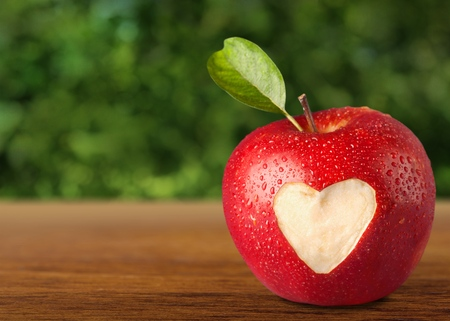 missing bite: Heart Shape on Apple. Stock Photo