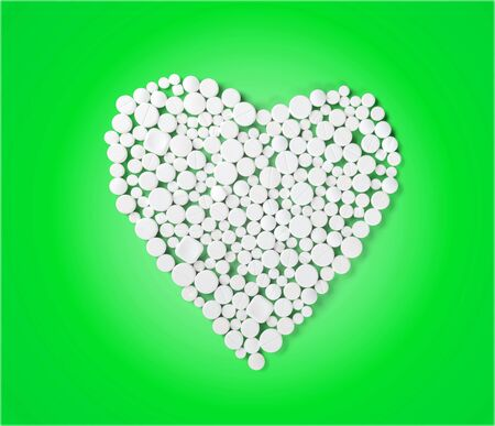sexual issues: Heart Shape Pills. Stock Photo