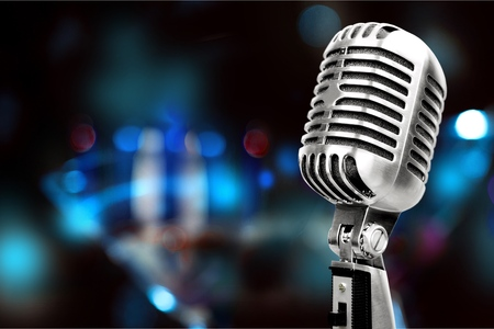 rock music background: Silver microphone.