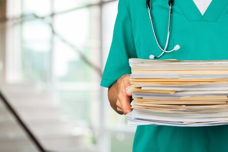 healthcare and medicine: Doctor Paperwork.
