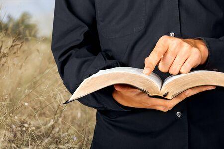 holding bible: Reading Bible.