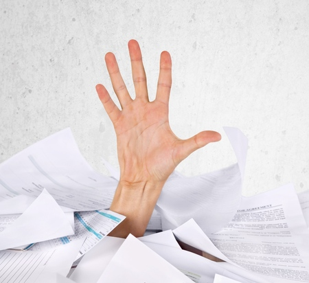 drowning: Paperwork Drowning. Stock Photo