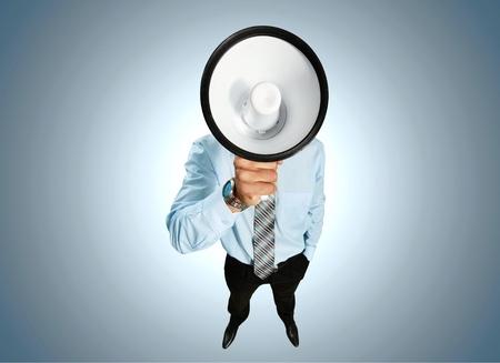 businessman using a megaphone: Using Voice Megaphone.