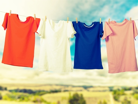 colourful sky: Hanging T-Shirts. Stock Photo