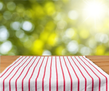 red cloth: Tablecloth on wooden deck. Stock Photo