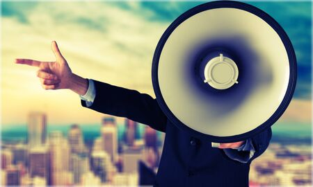 obscured face: Megaphone Shouting. Stock Photo