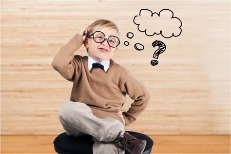 Pregunta Niño. Foto de archivo