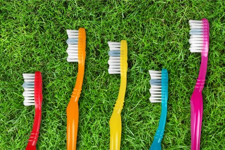 five objects: Toothbrushes. Stock Photo