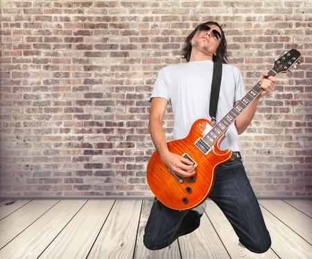 man playing guitar: Man Playing guitar. Stock Photo