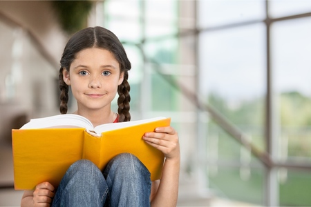 schoolgirl: Child reading a book
