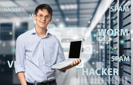 it: Man holding Laptop Stock Photo