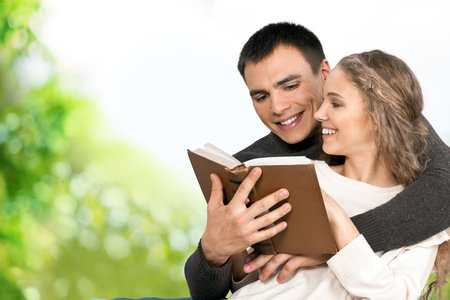 bibles: Couple reading bible book Stock Photo